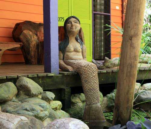 cement mermaid sculpture by monica