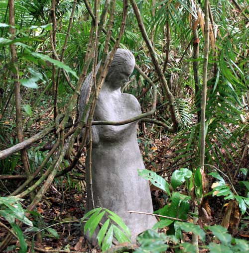 praying woman cement sculpture rainforest art gallery